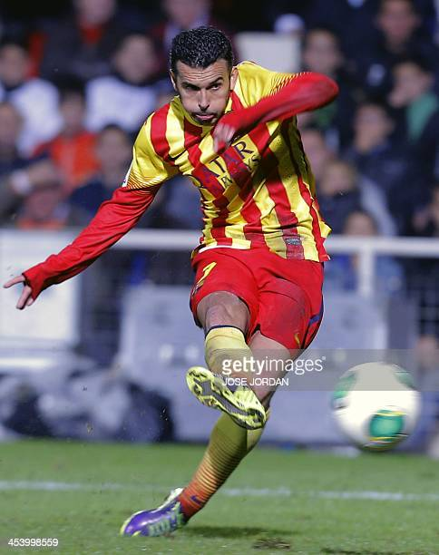 Barcelona's forward Pedro Rodriguez scores during the Spanish Copa del Rey Cartagena vs Barcelona finals stage match at the Cartagonova municipal...