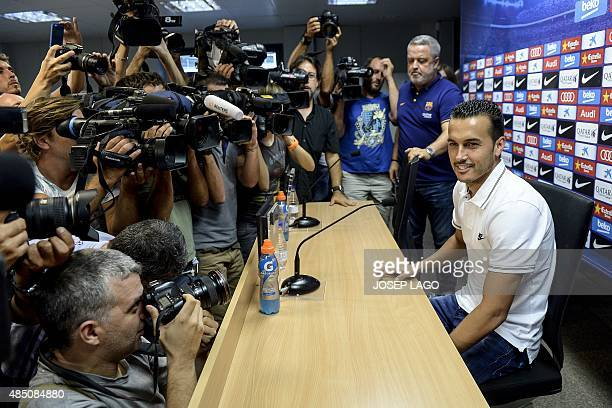 Barcelona's forward Pedro Rodriguez sits during a farewell press conference for his departure from the club to English football team Chelsea at the...