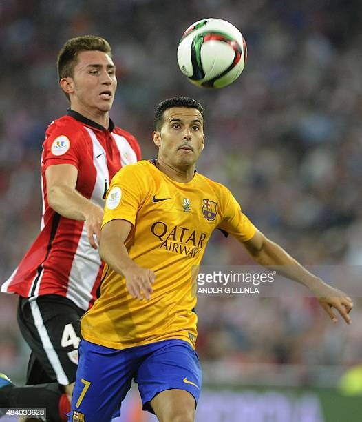 Barcelona's forward Pedro Rodriguez vies with Athletic Bilbao's defender Aymeric Laporte during the Spanish Supercup firstleg football match Athletic...