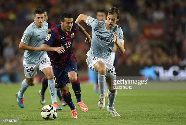 Barcelona's forward Pedro Rodriguez vies with Eibar's defender Abraham Minero and Eibar's defender Abraham Minero during the Spanish league football...