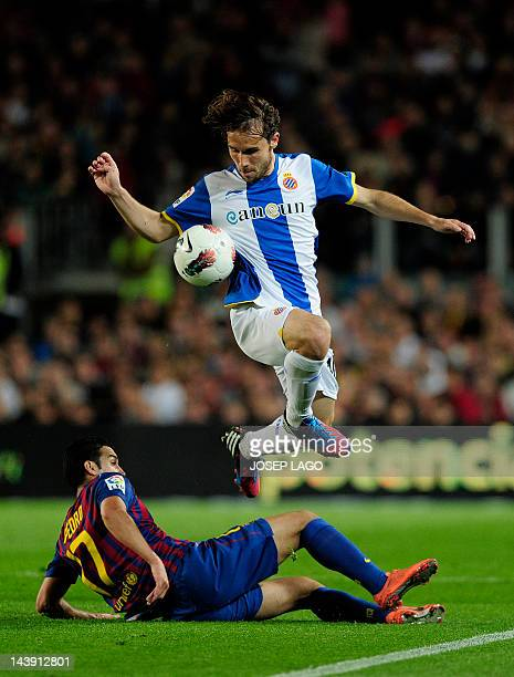 Barcelona's forward Pedro Rodriguez vies with Espanyol's midfielder Joan Verdu during the Spanish League football match FC Barcelona vs RCD Espanyol...