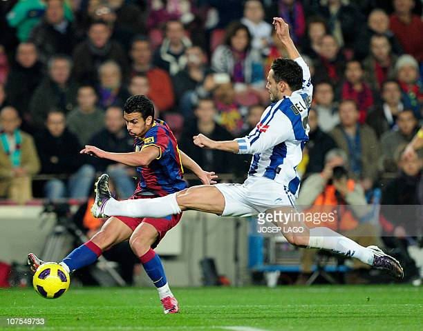 Barcelona's forward Pedro Rodriguez vies with Real Sociedad's defender Alberto de la Bella during their Spanish league football match at Camp Nou...