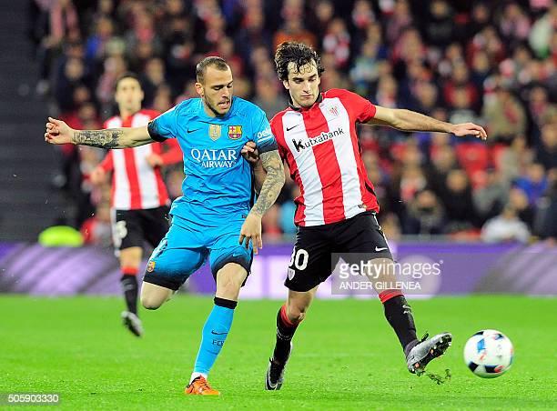 Barcelona's forward Sandro Ramirez vies with Athletic Bilbao's defender Inigo Lekue during the Spanish Copa del Rey football match Athletic Club de...