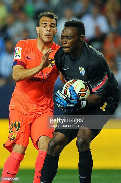 Barcelona's forward Sandro Ramirez vies with Malaga's Cameroonian goalkeeper Carlos Kameni during the Spanish league football match Malaga CF vs FC...