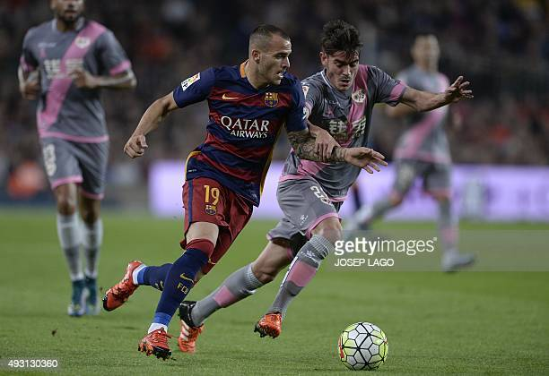 Barcelona's forward Sandro vies with Rayo Vallecano's midfielder Jozabed during the Spanish league football match FC Barcelona vs Rayo Vallecano de...
