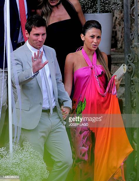 Barcelona's foward Lionel Messi and his girlfriend Antonella Roccuzzo arrive for the wedding ceremony of Spain's midfielder Andres Iniesta in...