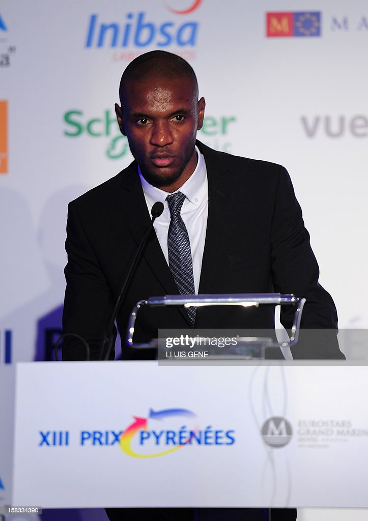 Barcelona's French defender Eric Abidal delivers a speech after receiving the XIII Prix Pyrenees award in Barcelona on December 13, 2012.