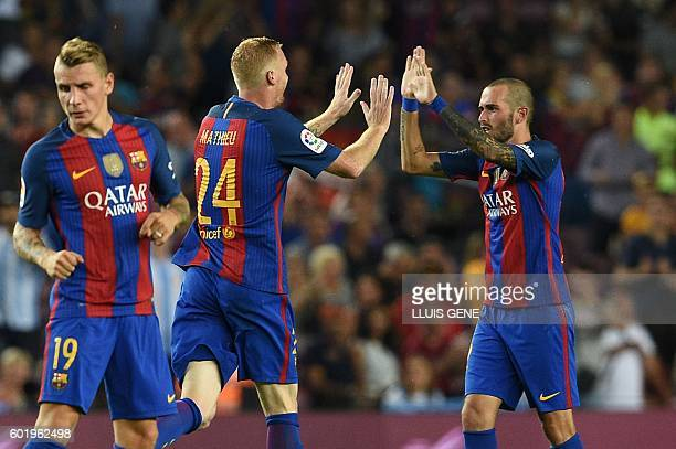 Barcelona's French defender Jeremy Mathieu celebrates a goal with Barcelona's defender Aleix Vidal during the Spanish league football match FC...