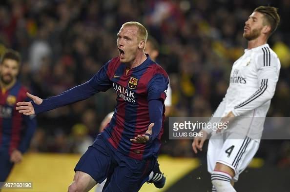 Barcelona's French defender Jeremy Mathieu celebrates after scoring a goal next to Real Madrid's defender Sergio Ramos during the 'clasico' Spanish...