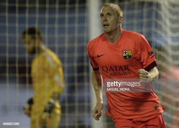 Barcelona's French defender Jeremy Mathieu celebrates after scoring a goal during the Spanish league football match RC Celta de Vigo vs FC Barcelona...