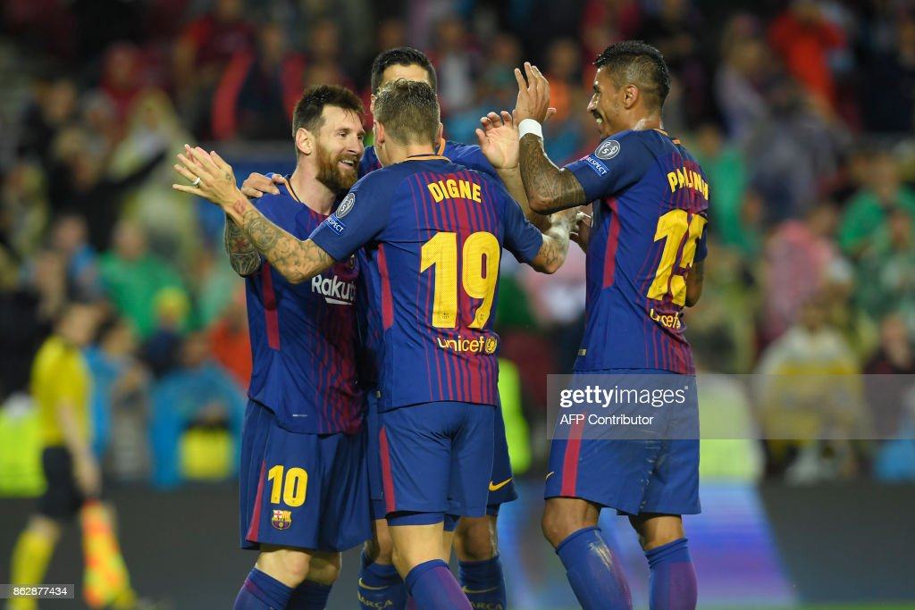 Barcelona's French defender Lucas Digne (C) celebrates a goal with teammates during the UEFA Champions League group D football match FC Barcelona vs Olympiacos FC at the Camp Nou stadium in Barcelona on Ocotber 18, 2017. /
