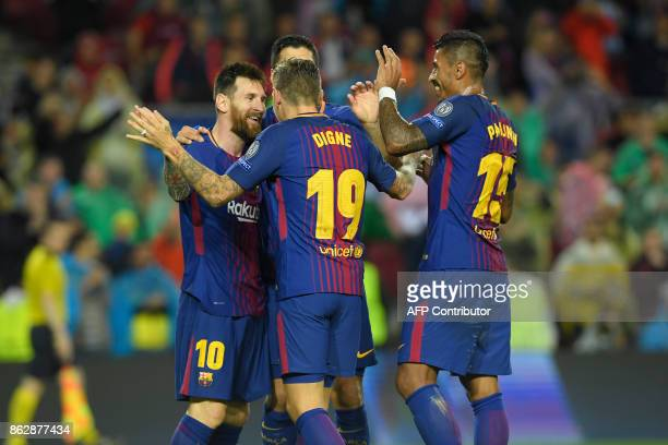 Barcelona's French defender Lucas Digne celebrates a goal with teammates during the UEFA Champions League group D football match FC Barcelona vs...