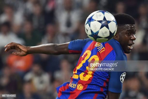 Barcelona's French defender Samuel Umtiti jumps for the ball during the UEFA Champions League quarter final first leg football match Juventus vs...