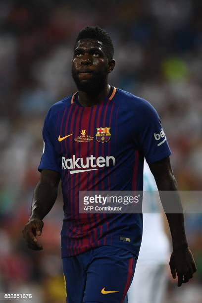 Barcelona's French defender Samuel Umtiti looks up during the second leg of the Spanish Supercup football match Real Madrid vs FC Barcelona at the...