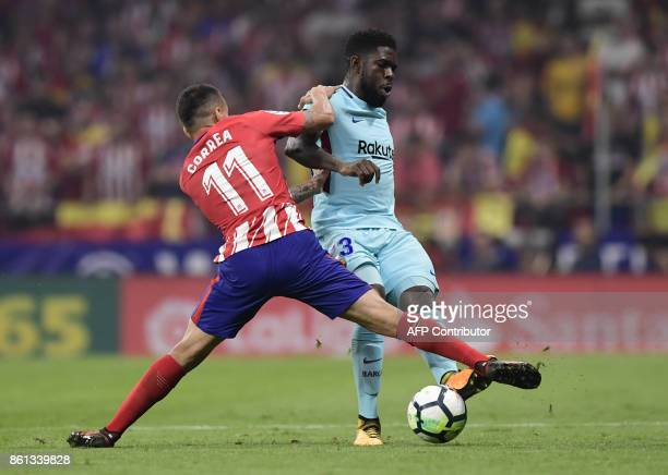 Barcelona's French defender Samuel Umtiti vies with Atletico Madrid's Argentinian forward Angel Correa during the Spanish league football match Club...