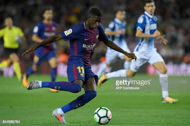 Barcelona's French forward Ousmane Dembele kicks the ball during the Spanish Liga football match Barcelona vs Espanyol at the Camp Nou stadium in...