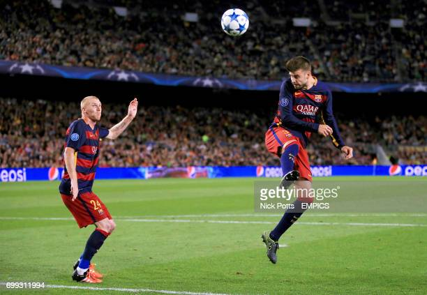 Barcelona's Gerard Pique and Jeremy Mathieu in action