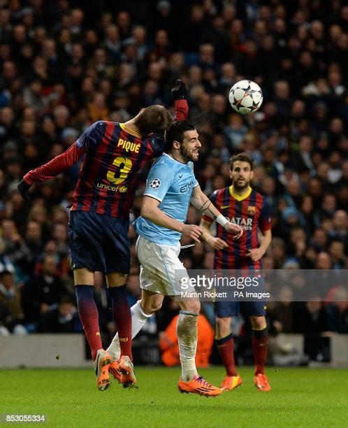 Barcelona's Gerard Pique and Manchester City's Alvaro Negredo battle for the ball