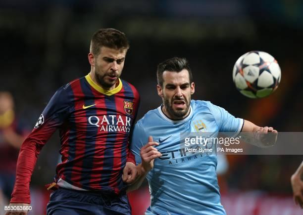 Barcelona's Gerard Pique and Manchester City's Alvaro Negredo
