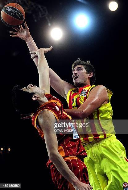 Barcelona's German center Tibor Pleiss vies for the ball with Galatasaray's forward Ege Arar during the Euroleague top 16 basketball match between...