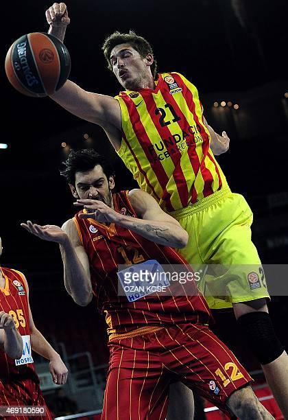 Barcelona's German center Tibor Pleiss vies for the ball with Galatasaray's forward Kerem Gonlum during the Euroleague top 16 basketball match...