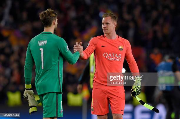 Barcelona's German goalkeeper MarcAndre Ter Stegen cheers Paris SaintGermain's German goalkeeper Kevin Trapp at the end of the UEFA Champions League...