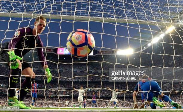 Barcelona's German goalkeeper MarcAndre Ter Stegen goes for the ball after Real Madrid's opening goal during the Spanish league football match Real...
