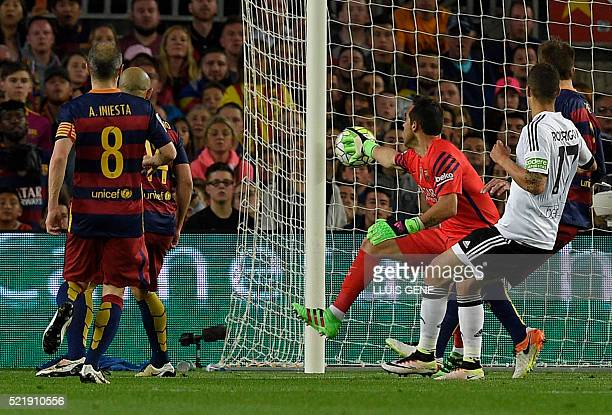 Barcelona's German goalkeeper MarcAndre Ter Stegen lets through a goal during the Spanish league football match FC Barcelona vs Valencia CF at the...
