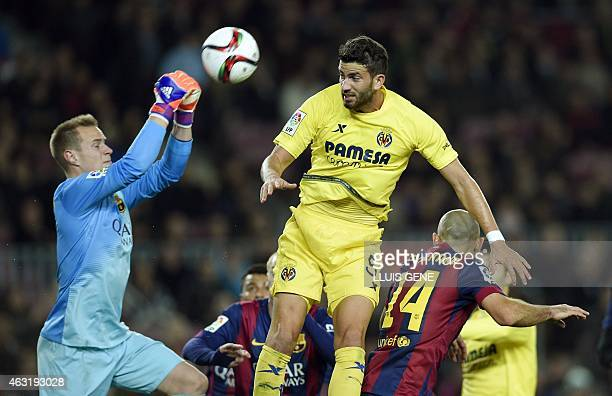 Barcelona's German goalkeeper MarcAndre ter Stegen vies with Villarreal's Argentinian defender Mateo Musacchio during the Spanish Copa del Rey...