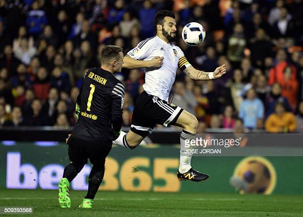 Barcelona's German goalkeeper MarcAndre Ter Stegen vies with Valencia's forward Alvaro Negredo during the Spanish Copa del Rey semifinal second leg...
