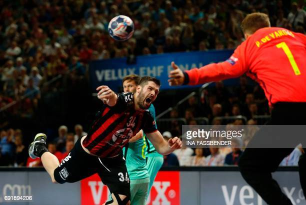 Barcelona's goalkeeper Gonzalo Perez de Vargas Moreno makes a save on Vardar's Vuko Borozan during Handball EHF Champions League Final Four semi...
