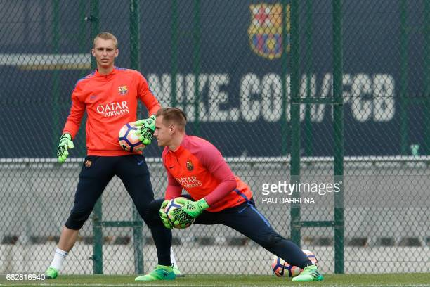 Barcelona's goalkeepers Jasper Cillessen from Netherlands and MarcAndre ter Stegen from Germany take part in a training session at the Sports Center...