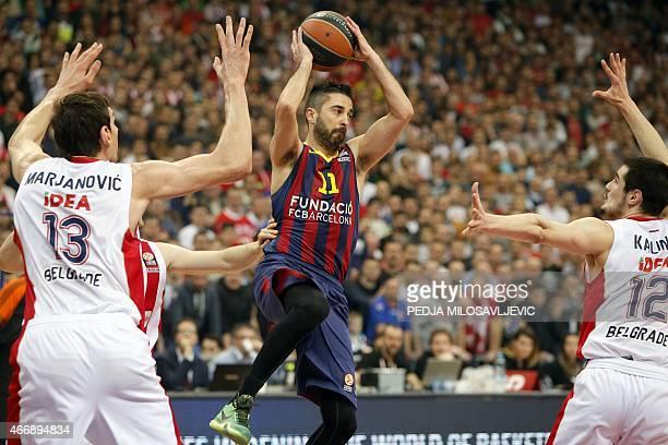 FC Barcelona's guard Juan Carlos Navarro fights for the ball with Crvena Zvezda's center Boban Marjanovic and forward Nikola Kalinic on March 19 2015...