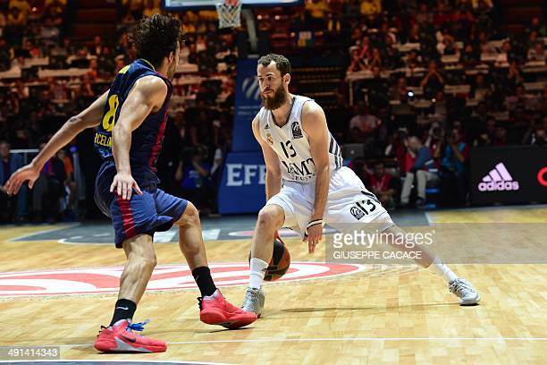 Barcelona's guard Victor Sada fights for the ball with Real Madrid's guard Sergio Rodriguez during their Euroleague semifinal match Barcelona vs Real...