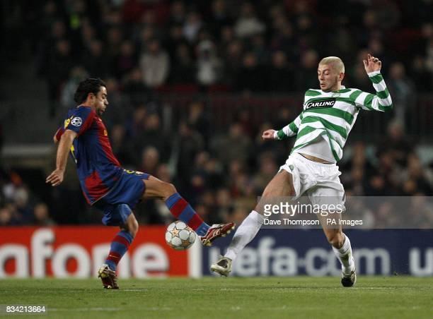 Barcelona's Hernandez Xavi and Celtic's Massimo Donati battle for the ball