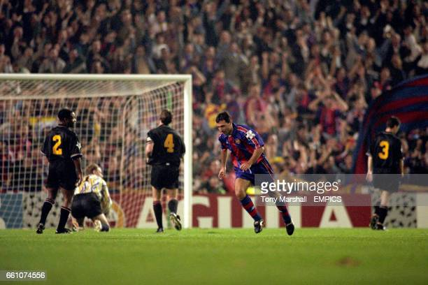 Barcelona's Hristo Stoitchkov runs off to celebrate his goal to the disappoinment of Manchester United's Paul Parker Gary Walsh Steve Bruce and Denis...