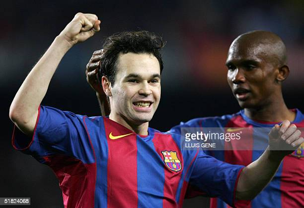 Barcelona's Iniesta and Samuel Eto'o celebrate their team's 3rd goal against Malaga's during their Spanish League football match at the Camp Nou...