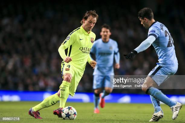 Barcelona's Ivan Rakitic takes on Manchester City's Martin Demichelis