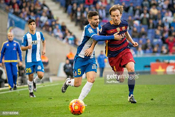 Barcelona's Ivan Rakitic vies with Espanyol's Burgui in action during the spanish football league between RCD Espanyol and FC Barcelona at Espa��ol...