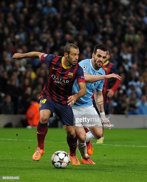 Barcelona's Javier Mascherano and Manchester City's Alvaro Negredo battle for the ball