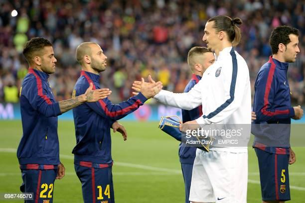 Barcelona's Javier Mascherano and Paris SaintGermain's Zlatan Ibrahimovic shake hands before the match
