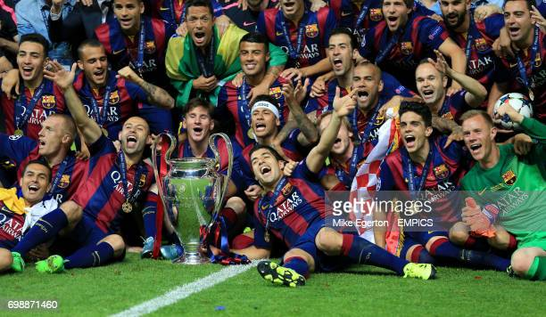 Barcelona's Javier Mascherano Lionel Messi Neymar and Luis Suarez celebrate with teammates and the trophy