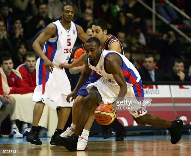 Barcelona's Juan Carlos Navarro vies with CSKA Moscow's John Robert Holden and Marcus Brown and Papaloukas during the EuroLeague basketball match...