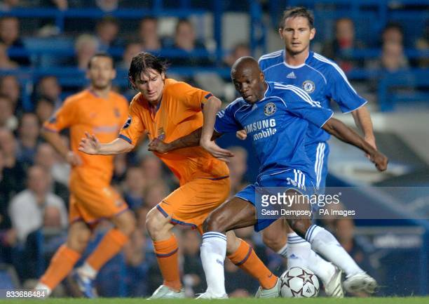 Barcelona's Leo Messi and Chelsea's Claude Makelele battle for the ball
