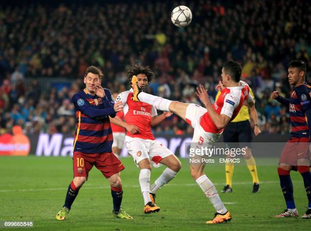 Barcelona's Lionel Messi and Arsenal's Gabriel Paulista in action
