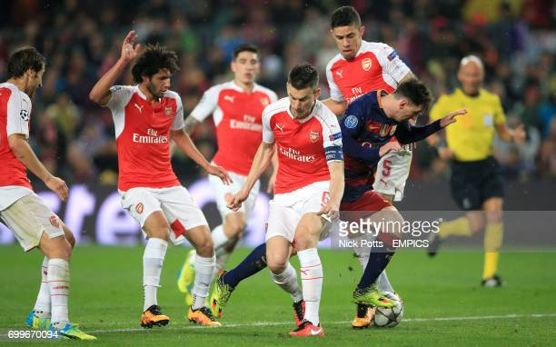 Barcelona's Lionel Messi attempts to take on the Arsenal defence