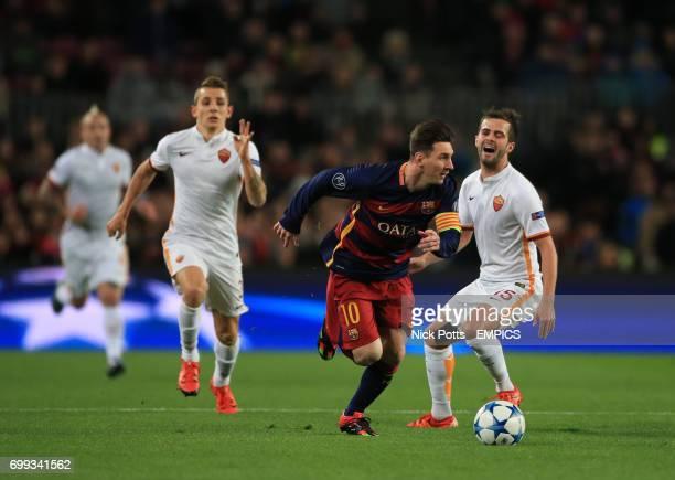 Barcelona's Lionel Messi beats AS Roma's Miralem Pjanic