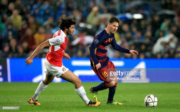 Barcelona's Lionel Messi gets away from Arsenal's Mohamed Elneny