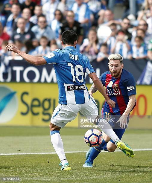 Barcelona's Lionel Messi in action against Pablo Insua of Leganes during the Spanish La Liga soccer match between FC Barcelona and Leganes at...
