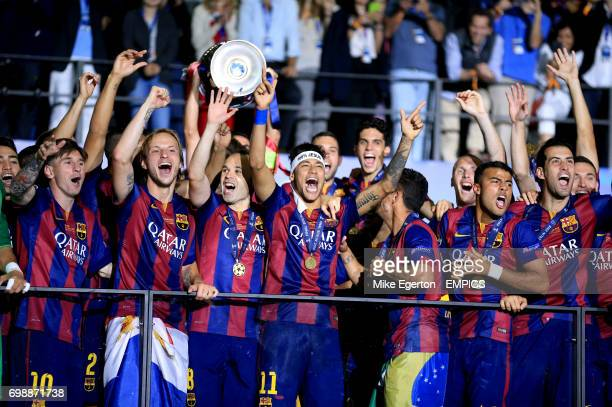 Barcelona's Lionel Messi Ivan Rakitic Andres Iniesta Neymar Rafinha and Sergio Busquets celebrate with the trophy